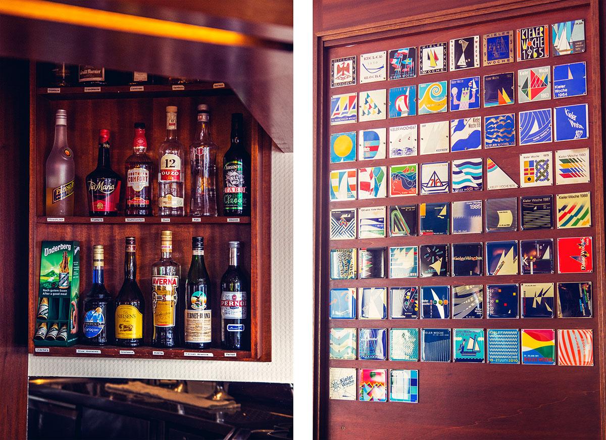 hotelbirke-kaminbar-kiwoschilder-flaschen